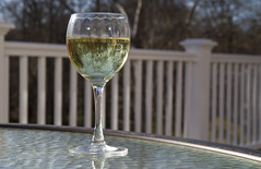 Deck Weather (brucetopher) Tags: light sun sunlight sunshine backlight spring afternoon wine upsidedown bend drink warmth rail clear deck cocktail backlit