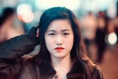 Tiffany (Jon Siegel) Tags: street portrait people woman girl beautiful night hongkong evening nikon serious bokeh 14 chinese 85mm busy redlipstick lankwaifong nikkor nikon85mmf14 d810