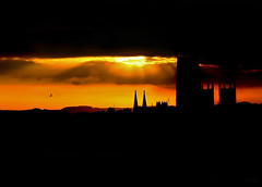 Durham Cathedral during a sunset (|| Rehnumah Insan ||) Tags: light sunset shadow england orange sun color building nature silhouette contrast canon dark landscape university durham cathedral natural zoom unitedkingdom outdoor famous landmark scene sunrays 28135 durhamcathedral canon600d