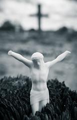 Plastic Jesus (emilyhorne) Tags: newmexico cemetery cross jesus creepy crucifix haunting plasticjesus lajoya