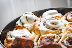 Sticky cinnamon buns (Arx0nt.) Tags: morning food brown kitchen cake horizontal breakfast dessert cafe eating cinnamon dough sugar gourmet indoors biscuit homemade snack pastry icing swirl flour baked crockery glazed refreshment rolledup stickybun cinnamonbun groupofobjects creamcheesefrosting danishpastry sweetbun sweetfood unhealthyeating