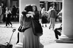 hug (jonron239) Tags: girls hands women hug emotion expression coventgarden column piazza elegant gesture denimjacket bigleatherbag