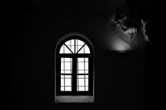 When light coexists harmoniously with  darkness (gkapne) Tags: light blackandwhite white black window monochrome dark nikon darkness giorgos d5100 gkapne kritsotakis