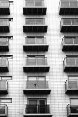 City Living (Richie Rue) Tags: city windows bw white black building monochrome architecture buildings manchester mono nikon apartments exterior centre center balconies d300