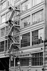 Back Streets (Richie Rue) Tags: street city bw white black building monochrome architecture buildings manchester fire mono back nikon escape centre center d300