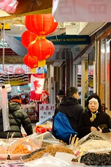 Market (411 Operator) Tags: street red people woman vancouver chinatown market stall flags