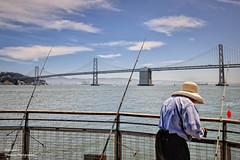 Fisherman in front of the Bay Bridge. San Francisco Bay (Abariltur) Tags: sanfrancisco california usa spain castelln pier7 oaklandbaybridge elembarcadero nikond90 afsdxnikkor1024mmf3545ged abariltur puentedelabaha isladeyerbabuena
