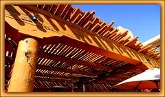 vigas (milomingo) Tags: wood blue light shadow orange newmexico southwest texture architecture dark wooden outdoor geometry pueblo stripe symmetry line beam adobe frame multiple viga linear rafter tamaya hyattregencytamayaresort