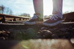the endless way. (Paul Reusch Photography) Tags: railroad light people sun art me 35mm germany way spring nikon shoes bokeh outdoor sigma rail hannover lensflare era sneaker vans colourful cinematic endless lookslikefilm sigmaart