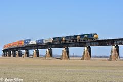 Csx 873 Leads a stack over the farm fields. (Machme92) Tags: railroad bridge sky clouds america rail trains row american rails railfan railroads csx railroading railfanning csxt railfans