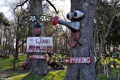 The Welcoming Committee (Studio 9265) Tags: old city trees red usa tree art apple face grass leaves sign museum america vintage mouth garden toy nose photography tv artwork eyes woods nikon rust faces outdoor dusk kentucky ky united parking country rusty dirty valley states fans van hillbilly calvert obsolete offbeat toyland 2016 unconventional 10am d5000