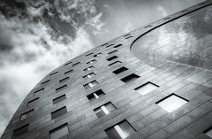 Curved (50D-Ray) Tags: windows sky blackandwhite monochrome architecture clouds rotterdam blaak curves shapes markthal maasstad