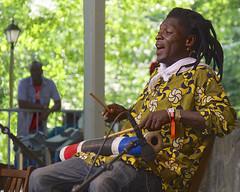 Haitian percussionist (andzwe) Tags: summer music netherlands dutch dreadlocks sticks concert singing african percussion live nederland bamboo clothes worldmusic nederlands balustrade chant haitian percussionist 2015 hertme afrikafestival hati panasonicdmcgh4 choukbwalibte