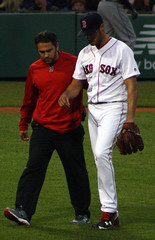 ...and Kelly is removed from the game (ConfessionalPoet) Tags: baseball injury redsox shoulder pitcher trainer rhp hanleyramirez firstbaseman joekelly impingement