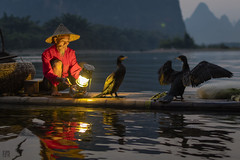 Gas Lamp on Li River (lycheng99) Tags: china reflection lamp reflections river cormorants landscape liriver wings fisherman guilin bamboo gaslamp cormorant raft karst guangxi bambooraft xingping chinatravel ljing karstformation