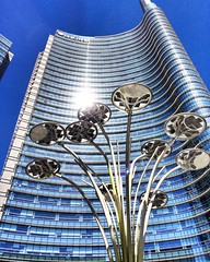 Milan, UniCredit Tower (emilio59) Tags: blue light italy sun milan building architecture soleil vanishingpoint italia cityscape milano bleu lumiere italie urbanlandscape architectura iphone