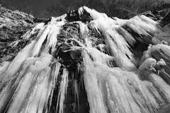 Icefall (Jae at Wits End) Tags: winter sky blackandwhite bw white black cold color ice nature water monochrome up weather rising grey frozen blackwhite cool colorful frost gray lookingup freeze icy bluffs rise multicolored chill upwards geological waterall rockstone