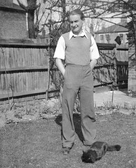 Man and cat in the garden (vintage ladies) Tags: blackandwhite house man smile smiling shirt cat vintage fence garden trousers jumper 30s 30sman