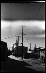 (|Digital|Denial|) Tags: winter sky blackandwhite sun snow 35mm backalley highcontrast powerlines wires expiredfilm