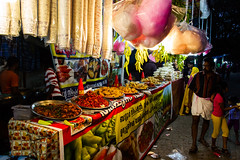 Browsing the Street Food (Nomadic Photographer) Tags: travel carnival food india streetphotography kerala wanderlust tropical vendor streetfood cochin kochi browsing fortkochi cochincarnival