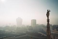 Milan (cranjam) Tags: italy panorama milan film fog skyline architecture skyscraper lomo lca lomography italia view cathedral spires milano vista duomo agfa grattacielo nebbia architettura duomodimilano bbpr gothicrevival torrevelasca guglie milancathedral neogotico vista200 velascatower studiobbpr
