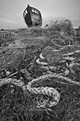 Fishermans Rest (SimonMastersPhotography) Tags: old uk blackandwhite net beach clouds boat kent decay rope dungeness obsolete fishingnets