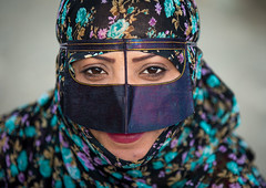 a bandari woman wearing a traditional mask called the burqa at panjshambe bazar thursday market, Hormozgan, Minab, Iran (Eric Lafforgue) Tags: portrait people woman face horizontal outdoors persian clothing asia veil mask iran market muslim islam religion hijab culture persia headshot hidden covered iranian bazaar adults adultsonly oneperson islamic traditionaldress burqa customs ethnicity middleeastern frontview sunni burka chador 20sadult youngadultwoman balouch hormozgan onewomanonly lookingatcamera burqua  bandari  1people  iro thursdaymarket  minab colourpicture  borqe panjshambe panjshambebazar boregheh iran034i2907