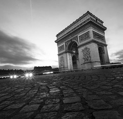 Arc de Triomphe with the massive Etoile roundabout. (quadriman brother) Tags: travel bw paris france architecture dusk cobblestone cobbles arcdetriomphe etoile longshutter