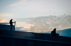 Enjoying the View (freyavev) Tags: camera sunset bird portugal girl birds silhouette wall clouds town photographer dusk seagull tripod grain blues porto blended grainy sillhouettes overlapping vsco