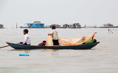 Children row home after attending their floating school on the Tonl Sap (amanda & allan) Tags: cambodia tonlsap