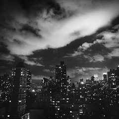 Manhattan Under Clouds (Adam Garelick) Tags: city nyc newyorkcity longexposure blackandwhite 120 6x6 film monochrome night mediumformat spring cityscape manhattan hasselblad 100 uppereastside fujineopanacros 2013 ilfordilfosol3