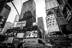 Times square (davidjhumphries) Tags: world new york city nyc black reflection apple skyline canon advertising square lights big skyscrapers bright manhattan gaudy l series times crossroads loud 1740mm flashy whitee 5dmkii
