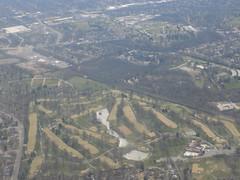 flight leaving Missouri (just me julie) Tags: trees window water buildings airplane seat missouri fromtheair takeninflight