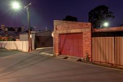 Little Red Garage (Andrew_Dempster) Tags: nightphotography urban night streetlight shadows nightscape nightshot streetlamp au australia nightlight sa southaustralia corrugatediron rosepark corrugatedfence stobie brickgarage