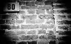 80 ! (CJS*64) Tags: street bw monochrome wall mono blackwhite spain nikon bricks number numbers nikkor dslr 80 malaga eighty nikkorlens d7000 nikond7000 18mm105mmlens