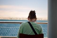Head down (Daniel.Lgnes) Tags: ocean blue sea woman patagonia mer tourism southamerica water girl lady mar tour femme think sightseeing momento wait moment turismo fille pensar sudamerica puertomadryn ocanoatlntico southatlanticocean