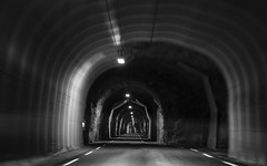 it's a rough and very narrow crossing (lunaryuna (off to Iceland for 2 weeks)) Tags: road travel bw monochrome norway architecture blackwhite solitude darkness transport tunnel journey lunaryuna lofotenislands lonelyroad roughcut itsallaboutmotion singlelanetunnel throughmountainsbelly