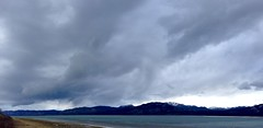 Squall descends on Lake Laberge, Yukon Territory. (Cameron Eckert) Tags: wild cloud lake snow storm mountains ice ecology rain weather clouds squall forest season spring wind north yukon melt wilderness burst marge northern boreal ecosystem biodiversity yukonriver sqall