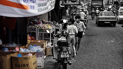 on the street where they live (j.p.yef) Tags: street people cars boys children asia traffic streetlife malaysia shops penang bicolor yef bwandcolor peterfey jpyef