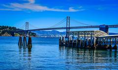 SF Bay Bridge along a ferry dock in San Francisco CA (mbell1975) Tags: ocean sf sanfrancisco california ca bridge sea usa water ferry america puente bay us dock san francisco wasser unitedstates bur cove calif ponte most cal american pont bro brug brcke along brig kpr bouwwerk