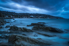 Laguna Beach - Here Comes The Rain_ (www.karltonhuberphotography.com) Tags: longexposure sky weather clouds landscape outdoors moody gloomy rainyday threatening stormy pacificocean southerncalifornia drama tension graysky theoc lagunabeach californiacoastline softlight grayday 2016 southcounty flowingwater diffusedlight turbulent distantlights smoothwater silkywater nikcolorefexpro horizontalimage orangecountycalifornia shorelinerocks karltonhuber vignettadded
