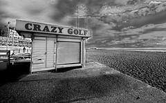 Closed Crazy Golf Kiosk (grahambrown1965) Tags: sea blackandwhite white seascape black beach water monochrome golf landscape sussex crazy brighton pentax shingle sigma crazygolf shore kiosk seafront eastsussex sigma1020mm brightonseafront pentaxk3ii k3ii ricohimagingcompanyltdpentaxk3ii