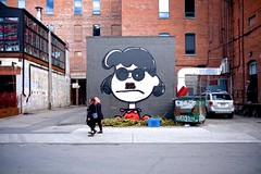 The Hipster is IN (cookedphotos) Tags: toronto art sunglasses graffiti lucy mural fuji cartoon hipster streetphotography peanuts sidewalk charlesschulz portlandstreet lucyvanpelt 23mm xt1