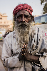 Poverty or a Lifestyle? (-gunjan) Tags: poverty life old city travel portrait india oldman palace turban wrinkles jaipur rajasthan citypalace