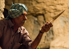butcher preparing the knives before the slaughter of a cow for a wedding, Qeshm Island, Tabl , Iran (Eric Lafforgue) Tags: wedding people man men horizontal night outdoors photography asia iran muslim islam traditional ceremony knife culture traditions marriage persia folklore celebration butcher tabi custom cultures adultsonly cultural oneperson islamic middleeastern persiangulf sunni qeshmisland menonly hormozgan tabl  bandari onemanonly  1people  iro straitofhormuz  colourpicture  irandsc02741