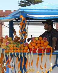 essaouira fruit vendor (kexi) Tags: africa blue portrait orange man vertical fruit canon march morocco maroc vendor oranges essaouira 2015 maroko instantfave