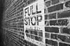 Full Stop (Georgie_grrl) Tags: blackandwhite toronto ontario building wall stencil angle bricks pentaxk1000 tagging fufu thejunction fullstop rikenon12828mm ilfordasa400 hangingoutwithmichael