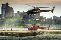 Busy Bees, NYC (dolbinator1000) Tags: new york city nyc sky building water buildings ky spray helicopter helicopters
