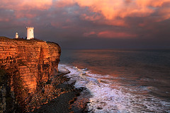 Last light on nash Point lighthouse 800 (Guy_Rogers) Tags: ocean sunset sea cliff lighthouse seascape southwales evening colourful nashpoint