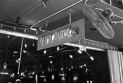 FAT'R GUTZ - Thong Lo Bangkok (jcbkk1956) Tags: blackandwhite film sign bar analog 35mm canon thailand lights mono fan bangkok rangefinder manual ilford thonglo fatgutz